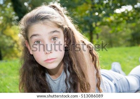 Preteen brunette girl in the forest smile