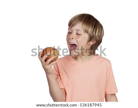 Preteen eating a red apple isolated on white background - stock photo