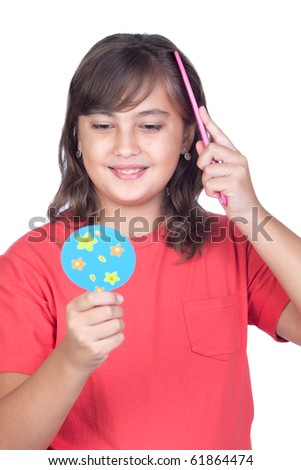 Preteen girl combing with a comb in front of a mirror isolated on ...