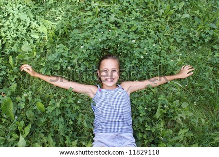 Preteen girl on grass background - stock photo