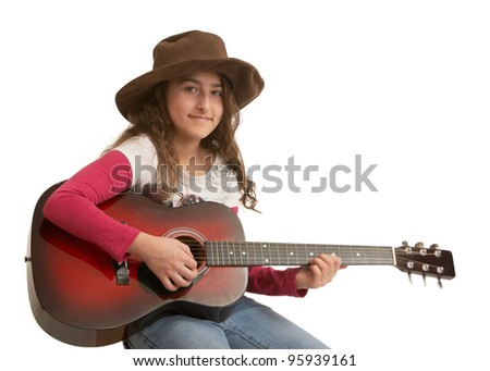 Preteen girl playing acoustic guitar isolated on white - stock photo