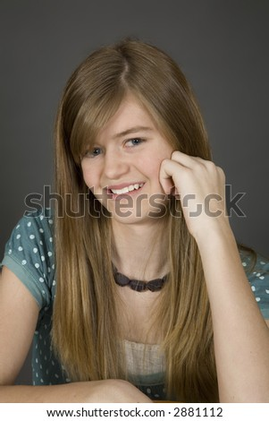 Preteen girl posing on gray background with some attitude - stock ...