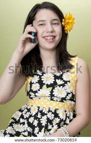 Preteen girl talking on cell phone