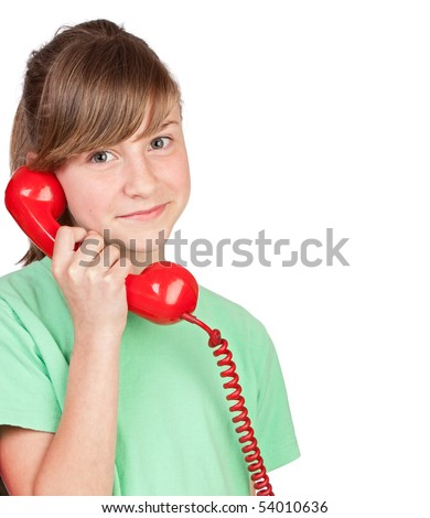 Preteen girl with red telephone on a over white background - stock photo