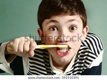 preteen handsome boy brush his strong white healthy teeth grimacing close up portrait - stock photo