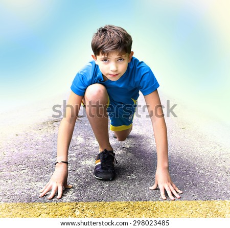 preteen handsome boy in sport clothes and shoes prepare to have running event contest - stock photo