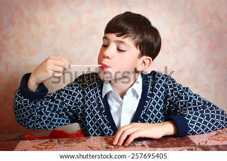 preteen handsome boy with chewing gum - stock photo
