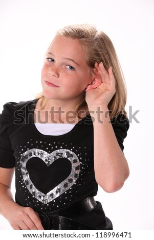 Preteen 10 year old female girl listening or hearing isolated against a white background. - stock photo