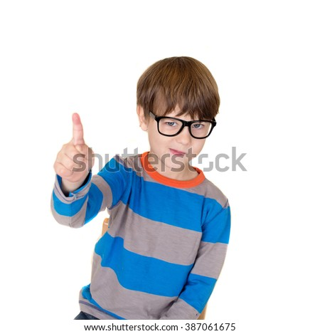 Pretend Play: child in glasses pretending to be a teacher and pointing, education or learning concept - stock photo