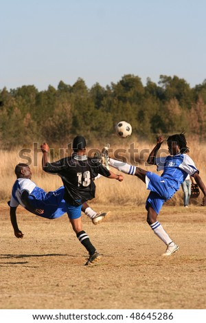 PRETORIA, SOUTH AFRICA - FEBRUARY 6: Local teams B-House and Timpro in a friendly match. Soccer fever is running high with the world cup only weeks away. February 6, 2010 in Pretoria, South Africa - stock photo