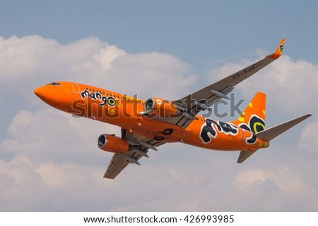 PRETORIA, SOUTH AFRICA-MAY 7 2016: A bright orange Mango Air Boeing 737 does a  flypast during the Swartkops Museum Airshow