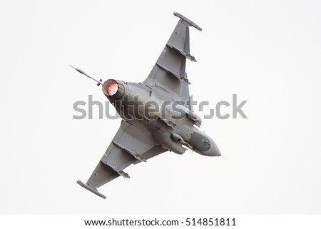 PRETORIA, SOUTH AFRICA-SEPTEMBER 17 2016: A Gripen fighter banks away with full afterburner  at  the African Air Defense show at AFB Waterkloof
