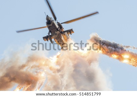 PRETORIA, SOUTH AFRICA-SEPTEMBER 17 2016: Rooivalk attack helicopter firing a dramatic salvo of flares at the African Air Defense show at AFB Waterkloof