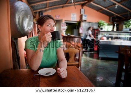 Pretty adult woman in a Costa Rican cafe - stock photo