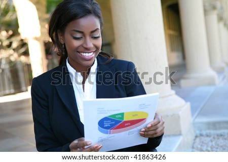 Pretty African American Business Woman  Holding Report - stock photo
