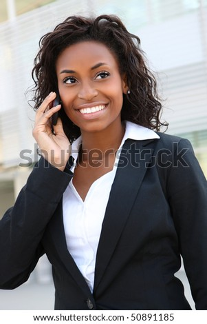 Pretty african american business woman talking on her mobile phone at office building