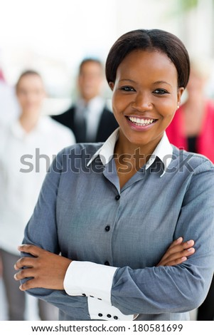 pretty african american corporate worker in office - stock photo