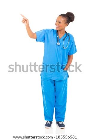 pretty african american healthcare worker pointing isolated on white background - stock photo