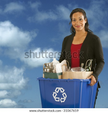 Pretty African American Woman holding a recyclables bin on a sky background - stock photo