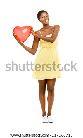Pretty African American woman holding Red Heart Balloon isolated on white background