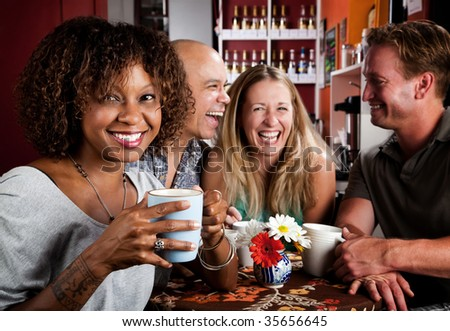 Pretty African American Woman in Coffee House with Friends - stock photo