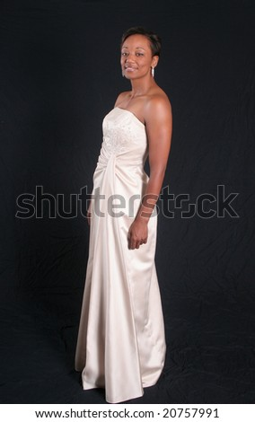 Pretty african american woman in white formal dress - stock photo