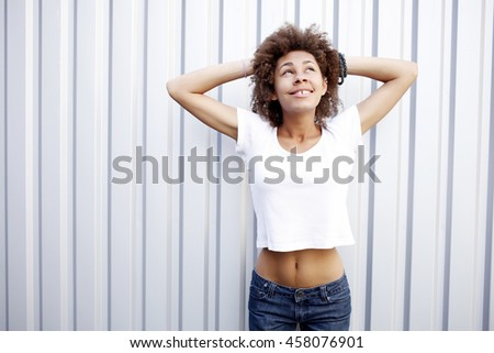 pretty african american woman looking up - stock photo