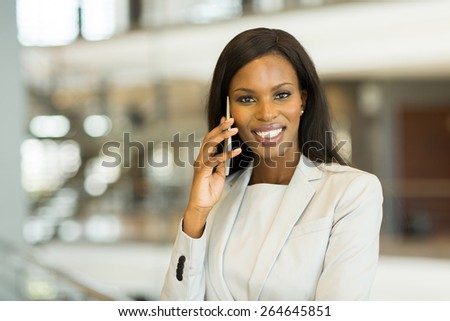 pretty african business woman making a phone call - stock photo