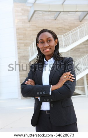 Pretty african business woman on smiling at office building