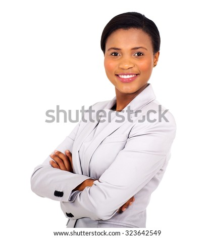 pretty african business woman with arms crossed on white background - stock photo
