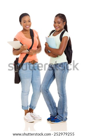 pretty african college students standing together isolated on white background - stock photo