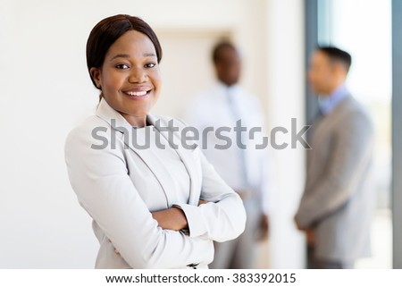 pretty african female corporate worker in office - stock photo