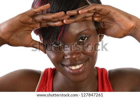 Pretty african girl smiling with hands on front, Studio shot,  Cameroon