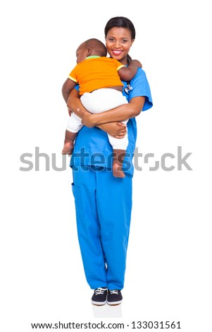 pretty african nurse carrying a child isolated on white - stock photo