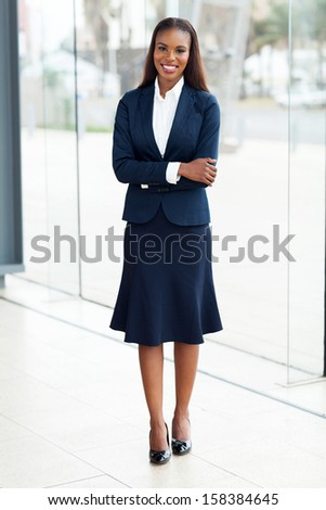 pretty african office worker with arms crossed - stock photo