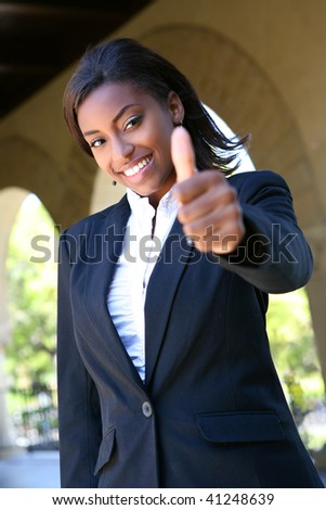 Pretty African Woman at College Signaling Success - stock photo