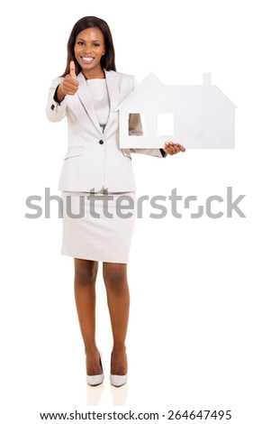 pretty afro american woman holding paper house and giving thumb up - stock photo