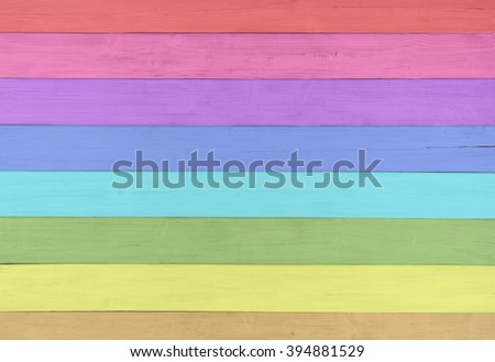 Pretty and Colorful Faux Painted Rustic Wood Boards in Rainbow Color Spectrum for Fun and Cheerful Background template with extra blank room or space for copy, text, your words, Horizontal photograph