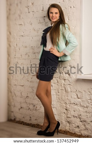 Pretty and confident business woman in a office  - stock photo