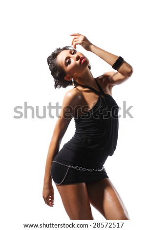 pretty and cute woman posing on studio background - stock photo