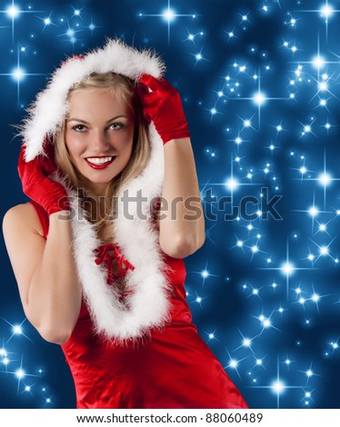 pretty and sensual blond girl in santa claus red dress posing a smiling with a nice hairstyle and hoody on