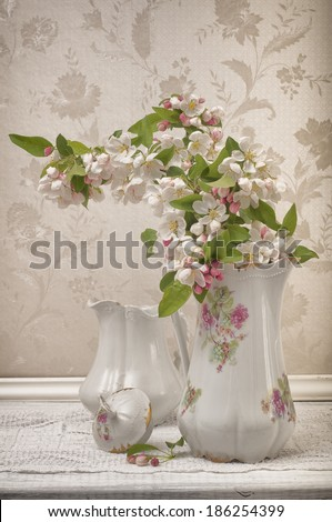 Pretty and Serene Vintage Still Life with Pitchers and Crabapple Blossoms.  Vertical - stock photo