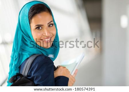 pretty arabian college girl on campus - stock photo