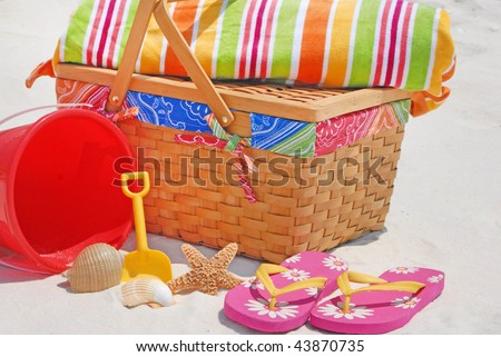 Pretty array of beach picnic supplies - stock photo