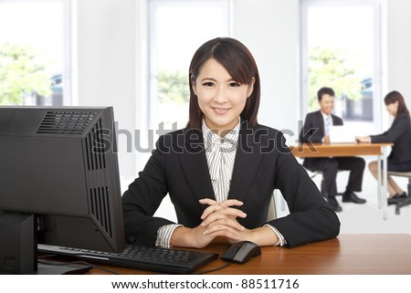 Pretty asian  business woman at office desk with computer - stock photo