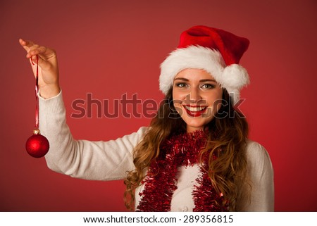 Pretty asian caucasian woman with santa claus hat celebrating christmas isolated over white background - stock photo