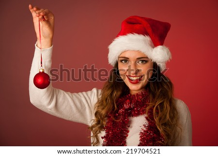 Pretty asian caucasian woman with santa claus hat celebrating christmass isolated over white background - stock photo