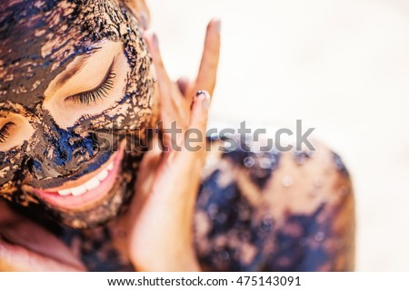 pretty asian girl applying chocolate face mask