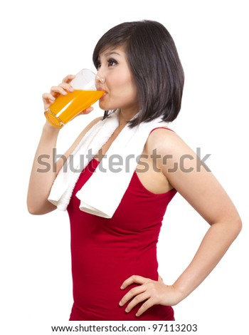 pretty asian girl drinking orange juice after exercise - stock photo