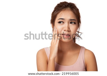 Pretty Asian girl has toothache  isolated on white background - stock photo